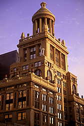 Stock photo of the architectural detail of the top of a building in the downtown Houston skyline.