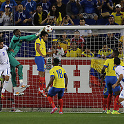Goalkeeper Alexander Dominguez and defender Christian Noboa, Ecuador, clear from a corner during the Ecuador Vs El Salvador friendly international football match at Red Bull Arena, Harrison, New Jersey. USA. 14th October 2014. Photo Tim Clayton