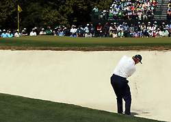 Ernie Els plays a shot from a bunker on the 1st hole during the third round of the Masters Tournament at Augusta National Golf Club in Augusta, Ga., on Saturday, April 8, 2017. (Photo by Curtis Compton/Atlanta Journal-Constitution/TNS) *** Please Use Credit from Credit Field ***