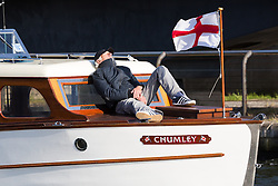 © Licensed to London News Pictures. 16/05/2015. London, UK. A man sleeps in the evening sunshine on Dunkirk Little Ship, Chumley as it arrives at Royal Victoria Docks in London today. Over 20 Dunkirk Little Ships have gathered in London toay before leaving in the morning to continue their journey to Dunkirk to mark the 75th anniversary of the Dunkirk Evacuations. Photo credit : Vickie Flores/LNP
