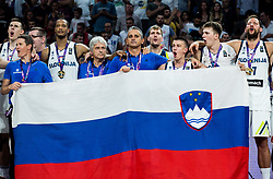 Vlatko Cancar of Slovenia, Jaka Lakovic, assistant coach of Slovenia, Anthony Randolph of Slovenia, Miljan Grbovic, assistant coach of Slovenia, Igor Kokoskov, coach of Slovenia, Zoran Dragic, Matic Rebec of Slovenia, Luka Doncic of Slovenia and Sasa Zagorac of Sloveniasinging National Anthem at Trophy ceremony after winning during the Final basketball match between National Teams  Slovenia and Serbia at Day 18 of the FIBA EuroBasket 2017 when Slovenia became European Champions 2017, at Sinan Erdem Dome in Istanbul, Turkey on September 17, 2017. Photo by Vid Ponikvar / Sportida