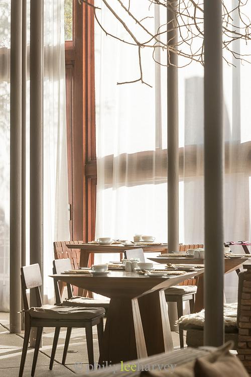 Restaurant interior with tables and chairs, Tierra Atacama Hotel, San Pedro de Atacama, Chile