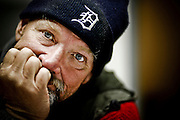 """SHOT 10/21/09 7:48:03 PM - Portraits of Rocky Mc aka """"Is-Real"""", 57, at the Denver Rescue Mission who was living on the streets for about nine months currently and has been homeless a number of times in his life. He said, """"I never dreamed that I'd have to do what I'm doing right now"""". He added that the streets can be a lonely and dangerous place at times. A recent survey by the Metro Denver Homeless Initiative estimates there are more than 11,000 homeless individuals in the seven county metro region and that numbers are up some 20 percent from 2007. (Photo by Marc Piscotty / © 2009)"""