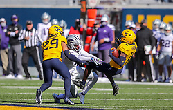 Oct 31, 2020; Morgantown, West Virginia, USA; West Virginia Mountaineers cornerback Nicktroy Fortune (11) intercepts a pass during the first quarter against the Kansas State Wildcats at Mountaineer Field at Milan Puskar Stadium. Mandatory Credit: Ben Queen-USA TODAY Sports