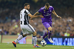 3rd June 2017 - UEFA Champions League Final - Juventus v Real Madrid - Karim Benzema of Real skips past Andrea Barzagli of Juventus - Photo: Simon Stacpoole / Offside.
