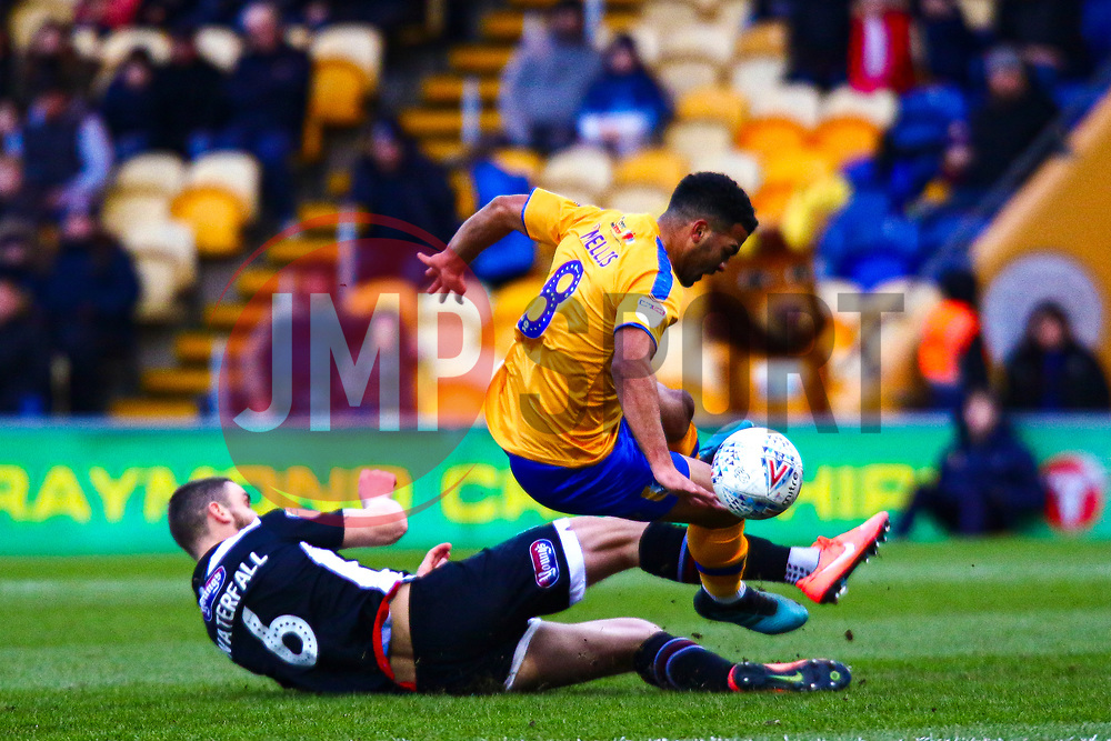 Luke Waterfall of Grimsby Town slides in for a bad challenge on Jacob Mellis of Mansfield Town - Mandatory by-line: Ryan Crockett/JMP - 04/01/2020 - FOOTBALL - One Call Stadium - Mansfield, England - Mansfield Town v Grimsby Town - Sky Bet League Two