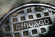 """SHOT 4/24/12 11:13:21 AM - A manhole cover in downtown Chicago, Ill. Chicago is the largest city in the US state of Illinois and the third most populous city in the United States, with around 2.7 million residents. Its metropolitan area, sometimes called """"Chicagoland,"""" is the third largest in the United States, with an estimated 9.8 million people within its metropolitan area. Chicago is the county seat of Cook County. Chicago has many nicknames, which reflect the impressions and opinions about historical and contemporary Chicago. The best known include: """"Chi-town,"""" """"Windy City,"""" """"Second City,"""" and the """"City of Big Shoulders. (Photo by Marc Piscotty / © 2012)"""