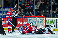 KELOWNA, BC - JANUARY 31: Referee Brayden Arcand stops the play as players collide with goalie Lukáš Pařík #33 of the Spokane Chiefs against the Kelowna Rocketsat Prospera Place on January 31, 2020 in Kelowna, Canada. (Photo by Marissa Baecker/Shoot the Breeze)