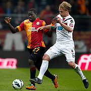 Galatasaray's Emmanuel Eboue (L) and Genclerbirligi's Bjorn Vleminckx (R) during their Turkish Super League soccer match Galatasaray between Genclerbirligi at the TT Arena at Seyrantepe in Istanbul Turkey on Friday, 08 March 2013. Photo by Aykut AKICI/TURKPIX