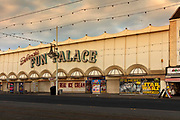 Fun Palace amusements closed during the pandemic on 21st April 2021 in Blackpool, Lancashire, United Kingdom. Blackpool is a large town and seaside resort in the county of Lancashire on the north west coast of England. Blackpool was once a booming resort with it's famous promenade which now, despite having a somewhat shabby appearance, still continues to attract millions of visitors each year. During the coronavirus pandemic however, Blackpool has struggled, with empty streets and closed down businesses creating an atmosphere more like a ghost town.
