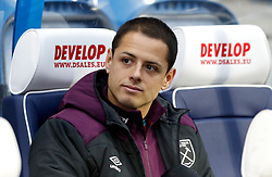 """West Ham United's Javier Hernandez on the bench during the Premier League match at the John Smith's Stadium, Huddersfield. PRESS ASSOCIATION Photo. Picture date: Saturday January 13, 2018. See PA story SOCCER Huddersfield. Photo credit should read: Martin Rickett/PA Wire. RESTRICTIONS: EDITORIAL USE ONLY No use with unauthorised audio, video, data, fixture lists, club/league logos or """"live"""" services. Online in-match use limited to 75 images, no video emulation. No use in betting, games or single club/league/player publications"""