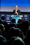 Americans For Prosperity President Tim Phillips speaks during the Defending the American Dream Summit hosted by Americans For Prosperity at the Omni Hotel in Dallas, Texas on August 29, 2014. (Cooper Neill for The New York Times)