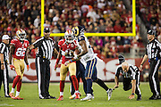 Side judge Gary Cavaletto (60) is knocked down by Los Angeles Rams cornerback Trumaine Johnson (22) during a fumble recovery against the San Francisco 49ers at Levi's Stadium in Santa Clara, Calif., on September 12, 2016. (Stan Olszewski/Special to S.F. Examiner)