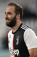 Juventus's Argentinian striker Gonzalo Higuain smiles after scoring to give the side a 3-0 lead during the Serie A match at Allianz Stadium, Turin. Picture date: 26th June 2020. Picture credit should read: Jonathan Moscrop/Sportimage