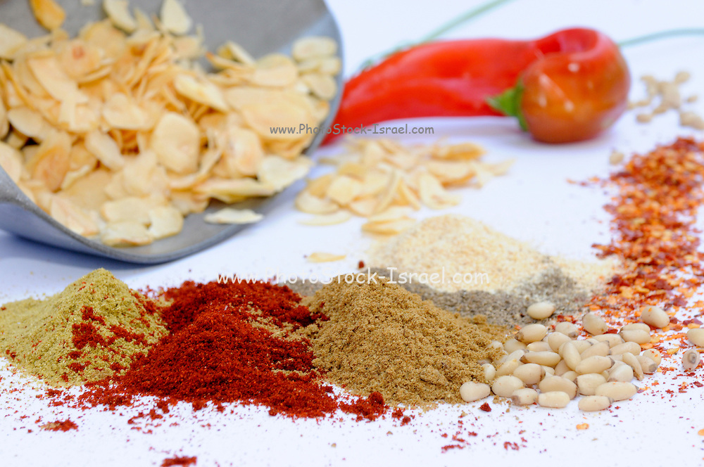 Still life of herbs and spices on white table