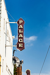 Palace Theater with Watchman sculpture in background on Main Street, Grapevine, Texas USA