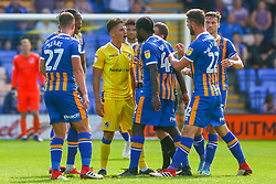 Tom Nichols of Bristol Rovers is confronted by Shrewsbury players after his tackle on Alex Gilliead of Shrewsbury Town  - Mandatory by-line: Ryan Hiscott/JMP - 01/09/2018 - FOOTBALL - Montgomery Waters Meadow - Shrewsbury, England - Shrewsbury Town v Bristol Rovers - Sky Bet League One