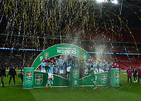 Football - 2018 Carabao (EFL/League) Cup Final - Manchester City vs. Arsenal<br /> <br /> Manchester City players celebrate with the trophy on the winners podium at Wembley.<br /> <br /> COLORSPORT/DANIEL BEARHAM