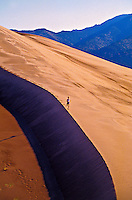 Woman running, Great Sand Dunes National Park, near Alamosa, Colorado USA