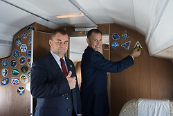 Expedition 57 crewmembers Alexey Ovchinin of Roscosmos (left) and Nick Hague of NASA (right) arrive at their launch site in Baikonur, Kazakhstan Sept. 25 for final pre-launch training after a flight from their training base in Star City, Russia. Hague and Ovchinin will launch Oct. 11 from the Baikonur Cosmodrome in Kazakhstan on the Soyuz MS-10 spacecraft for a six-month mission on the International Space Station<br /> <br /> NASA/Victor Zelentsov