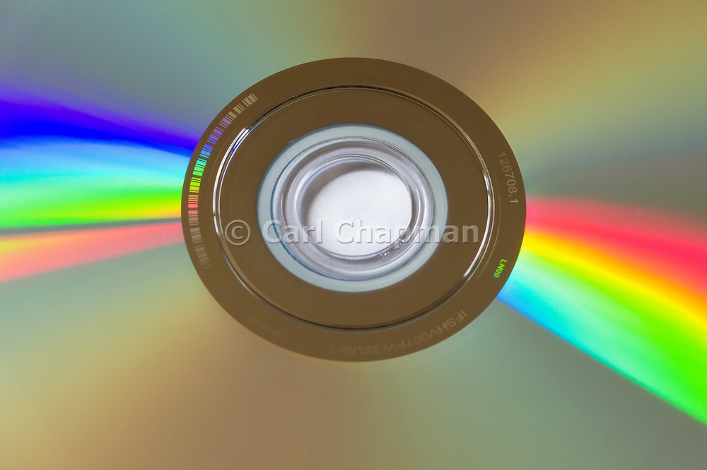 DVD disk light refraction. Computer and electronic data storage.  <br /> <br /> Editions:- Open Edition Print / Stock Image