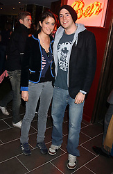 JASPER KAVANAGH and VIOLET VON WESTENHOLTZ at the opening party for a new bowling alley All Star Lanes, at Victoria House, Bloomsbury Place, London on 19th January 2006.<br />