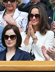 Image ©Licensed to i-Images Picture Agency. 26/06/2014. London, United Kingdom. Pippa Middleton and Michelle Dockery  in the Royal Box on day four of the Wimbledon Tennis Championships. Picture by Stephen Lock / i-Images