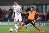 Gylfi Sigurdsson of Swansea city (L) in action with Curtis Weston of Barnet (R). Pre-season friendly match, Barnet v Swansea city at the Hive in London on Wednesday 12th July 2017.<br /> pic by Steffan Bowen, Andrew Orchard sports photography.