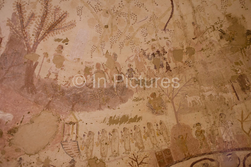 Fresco paintings inside the Exodus chapel in al-Bagawat Coptic necropolis, the remains of mud brick Christian tombs in the Western Desert, Egypt. Al-Bagawat, (also, El-Bagawat) one of the oldest and best preserved ancient Christian cemeteries in the world, which functioned at the Kharga Oasis in southern-central Egypt from the 3rd to the 7th century AD. Coptic frescoes of the 3rd to the 7th century are found on the walls and there are 263 funerary chapels of which the Chapel of Exodus (5th or 6th century) and Chapel of Peace (of mid 4th century) have frescoes.