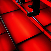 People standing on red steps in Times Square in New York City, New York, USA