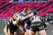 St Helens winger Tommmy Makinson (2) is well held by Hull FC players during the Betfred Super League match between Hull FC and St Helens RFC at Kingston Communications Stadium, Hull, United Kingdom on 16 February 2020.