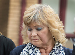 "© Licensed to London News Pictures. 03/06/2016. Woking, UK.  Doreen James listens as her husband Des James speaks to reporters as they leave Woking Coroner's Court. A second inquest into the death of army recruit Private Cheryl James has announced its verdict today. Coroner Brian Barker QC has ruled the death of Private James was caused by a ""self-inflicted"" wound. Cheryl was found dead with a bullet wound to her head in November 1995.  Aged just 18 she was one of four young soldiers who died at the Deepcut Barracks in Surrey between 1995 and 2002, amid claims of bullying and abuse. Photo credit: Peter Macdiarmid/LNP"