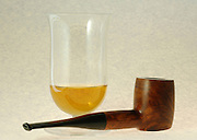 still life, Old wooden pipe and a glass of single malt highlands scotch whiskey on white background