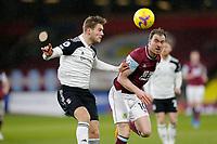 Football - 2020 / 2021 Premier League - Burnley vs. Fulham<br /> <br /> Joachim Andersen of Fulham clears under pressure from Ashley Barnes of Burnley, at Turf Moor.<br /> <br /> <br /> COLORSPORT/ALAN MARTIN