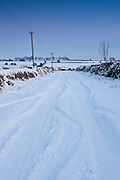 Country lane in deep snow in The Cotswolds, Swinbrook, Oxfordshire, United Kingdom