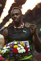 July 21, 2017 - Monaco, Monaco - Usain Bolt of Jamaica celebrates on the podium with his medal after winning the 100m of the IAAF Diamond League Herculis meeting at the Stade Louis II in Monaco on July 17, 2017. (Credit Image: © Manuel Blondeau via ZUMA Wire)