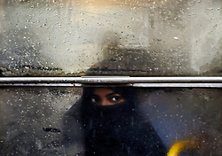 "May 3, 2019 - Kolkata, India - A woman looks outside from a bus window in Kolkata on 03 May, 2019 as the cyclonic storm ""Fani"" hits the coastal places of Orissa and West Bengal on 03 May 2019. Due to the cyclonic storm, light to moderate rainfall at most places with heavy to very heavy (7-20cm) rainfall at few places in Kolkata, East and West Midnapur, Jhargram, North and South 24 Parganas, Howrah and Hoogly districts of West Bengal according to the IMD (Indian Meterological Department) of Kolkata. (Credit Image: © Indranil Aditya/NurPhoto via ZUMA Press)"