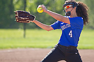 Middletown, New York - A Middletown pitcher winds up during a varsity girls' softball game on May 19, 2014.