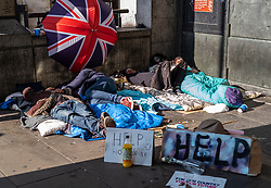 FILE IMAGE © Licensed to London News Pictures. 21/10/2019. London, UK. Freddy's makeshift home of cardboard mattresses and lightweight blankets which he shares with other rough sleepers is in an arcade next to Westminster tube Station and less than 100 yards from the Houses of Parliament. They are trying to raise money for a new tent that was mistakenly taken away by the Police during the XR demonstrations. Pictures highlight the reality of homelessness in Westminster taken during the build up of Brexit and the General election just a few hundreds yards from Parliament and Downing Street. Photo credit: Alex Lentati/LNP