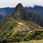 Machu Picchu is an Incan citadel set high in the Andes Mountains in Peru, above the Urubamba River valley. Built in the 15th century and later abandoned, it's renowned for its sophisticated dry-stone walls that fuse huge blocks without the use of mortar, intriguing buildings that play on astronomical alignments and panoramic views. Its exact former use remains a mystery.