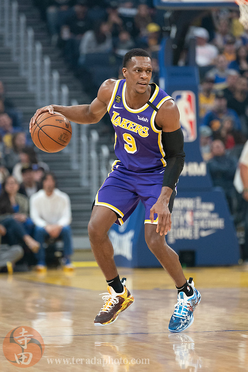February 27, 2020; San Francisco, California, USA; Los Angeles Lakers guard Rajon Rondo (9) dribbles the basketball during the first quarter against the Golden State Warriors at Chase Center.