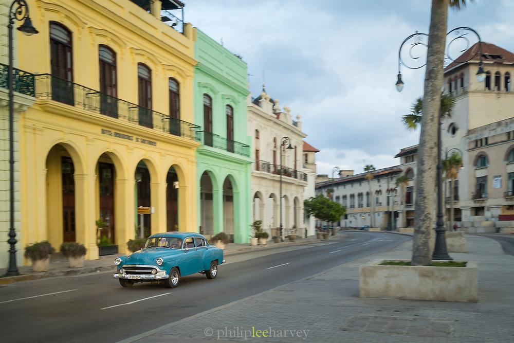 Vintage car on street near buildings and hotel Armadores de Santander, Havana, Cuba