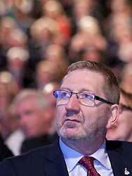 © Licensed to London News Pictures. 02/10/2012. Manchester, UK . Len McCluskey in the audience listens to the speech . Ed Miliband delivers his speech to the Labour Party Conference at Manchester Central . Photo credit : Joel Goodman/LNP