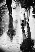 Pedestrians on a rainy day, Paris, France