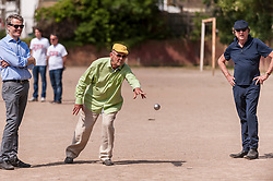 """© Licensed to London News Pictures. 05/06/2015.   London, UK. Jim Beach (centre), manager of the rock band, Queen, watched by Monty Python star, Eric Idle (right), takes part in """"Freddie for the Day"""", by playing a special game of celebrity Pétanque, competing for the Londonaise 'Celebrity Pétanque Trophy', ahead of The Londonaise Pétanque festival this weekend in Barnard Park, Islington.  The festival will set a new precedent in the UK with 128 teams taking part in the main tournament.  The event also aims to raise funds for the Mercury Phoenix Trust to fight against AIDS worldwide. Photo credit : Stephen Chung/LNP"""