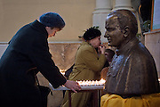 Moscow, Russia, 02/04/2005..As Pope John Paul ll lies close to death in the Vatican, Russian Catholics pray for him inside the Cathedral of the Virgin Mary's Immaculate Conception, Russia's largest Roman Catholic church. Worshippers light candles and pray beside a bust of Pope John Paul ll.