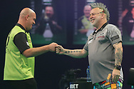 Michael van Gerwen and Peter Wright during the PDC Unibet Premier League darts at Marshall Arena, Milton Keynes, United Kingdom on 27 May 2021.