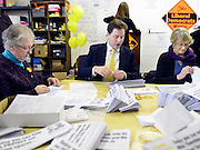 © Licensed to London News Pictures. 27/02/2013. Eastleigh, UK. Leader of the Liberal Democrats and Deputy Prime minister Nick Clegg (centre) and Liberal Democrat Parliamentary Candidate for Eastleigh, Mike Thornton (not pictured) help pack campaign leaflets at the Liberal Democrat campaign headquarters in Eastleigh today 27th February 2013. Polling takes place across the borough tomorrow.  Photo credit : Stephen Simpson/LNP