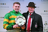 National Hunt Horse Racing - 2019 Cheltenham Festival - Friday, Day Four (Gold Cup Day)<br /> <br /> Jonjo O'Neill Jr. on Early doors with his Father after winning in the 17.30 Martin Pipe Condtional Jockeys' handicap hurdle race at Cheltenham Racecourse.<br /> <br /> COLORSPORT/ANDREW COWIE