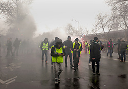 19 January 2019. Paris, France.<br /> Gilets Jaunes - Acte X take to the streets of Paris. Tear gas mixes with smoke from flares at the end of the demonstration. An estimated 7,000 people took part in the looping 14 km route from Place des Invalides to protest tax hikes from the Government of Emmanuel Macron imposed on the people. An estimated 80,000 people took part in protests across the country. Regrettably the movement has attracted a violent element of agitators who often face off with riot police at the end of the marches which tends to deflect attention away from the message of the vast majority of peaceful protesters.<br /> Photo©; Charlie Varley/varleypix.com